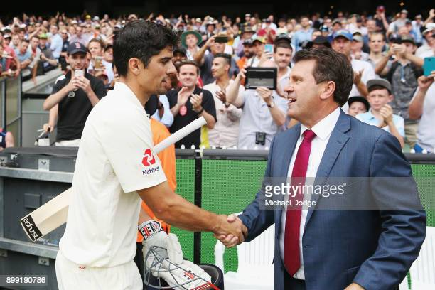 Alastair Cook of England shakes hands with former Australian Captain Mark Taylor at the close of play after making 244 not out during day three of...