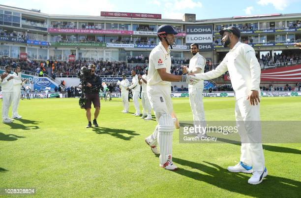 Alastair Cook of England shakes hands with Virat Kohli of India is given a guard of honour as he walks out to bat during day one of the Specsavers...