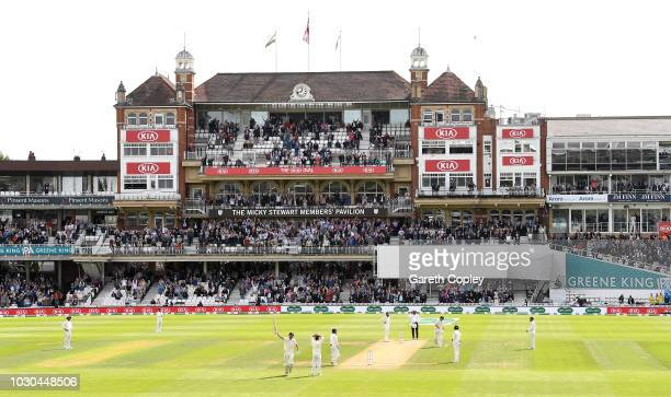 Alastair Cook of England waits for the crowd to stop cheering after scoring his century during day four of the Specsavers 5th Test match between...