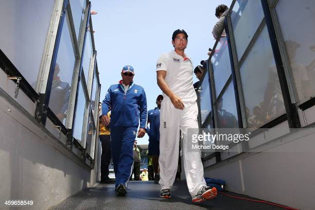 Alastair Cook of England walks offf thr ground after defeat during day four of the Fourth Ashes Test Match between Australia and England at Melbourne...