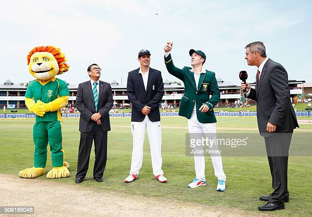 Alastair Cook of England watches as AB de Villiers of South Africa performs the coin toss during day one of the 4th Test at Supersport Park on...