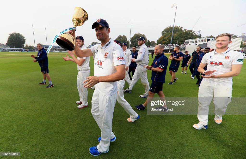 Alastair Cook of Essex lifts the County Championship trophy during day three of the Specsavers County Championship Division One match between Essex and Yorkshire at the Cloudfm County Ground on September 27, 2017 in Chelmsford, England.