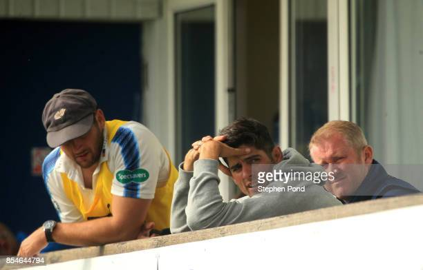 Alastair Cook of Essex looks on from the players balcony during day three of the Specsavers County Championship Division One match between Essex and...