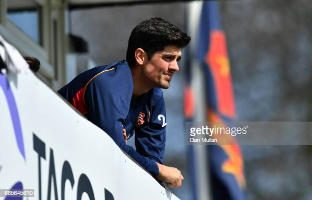 Alastair Cook of Essex looks on from the team balcony after being ruled out of the match with an injury during day one of the Specsavers County...