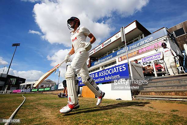Alastair Cook of Essex makes his way onto the field ahead of the start of play on day two of the Specsavers County Championship Division Two match...