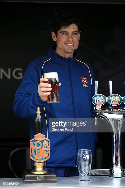 Alastair Cook of Essex pours pints of beer during the Essex County Cricket Club media day at The County Ground on April 7 2016 in Chelmsford England