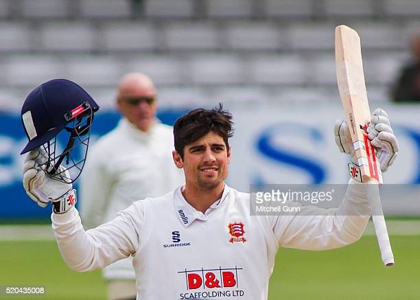 Alastair Cook of Essex raises his bat and celebrates scoring a century during the Specsavers County Championship match between Essex and...
