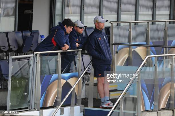 Alastair Cook of Essex talks to Ian Bell and Jonathan Trott of Warwickshire during the County Championship Division One match between Warwickshire...