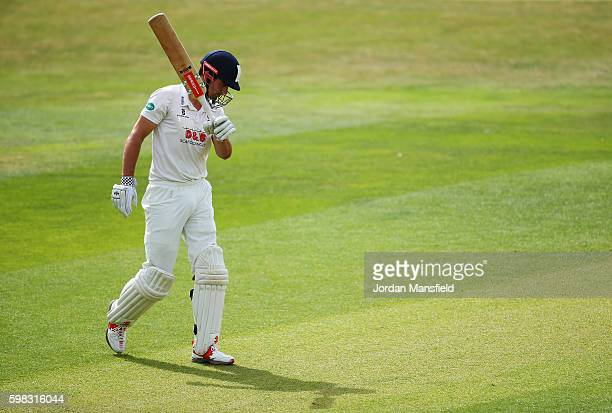 Alastair Cook of Essex walks off the field after being caught out by Ross Whiteley of Worcestershire bowled Ed Barnard of Worcestershire during day...
