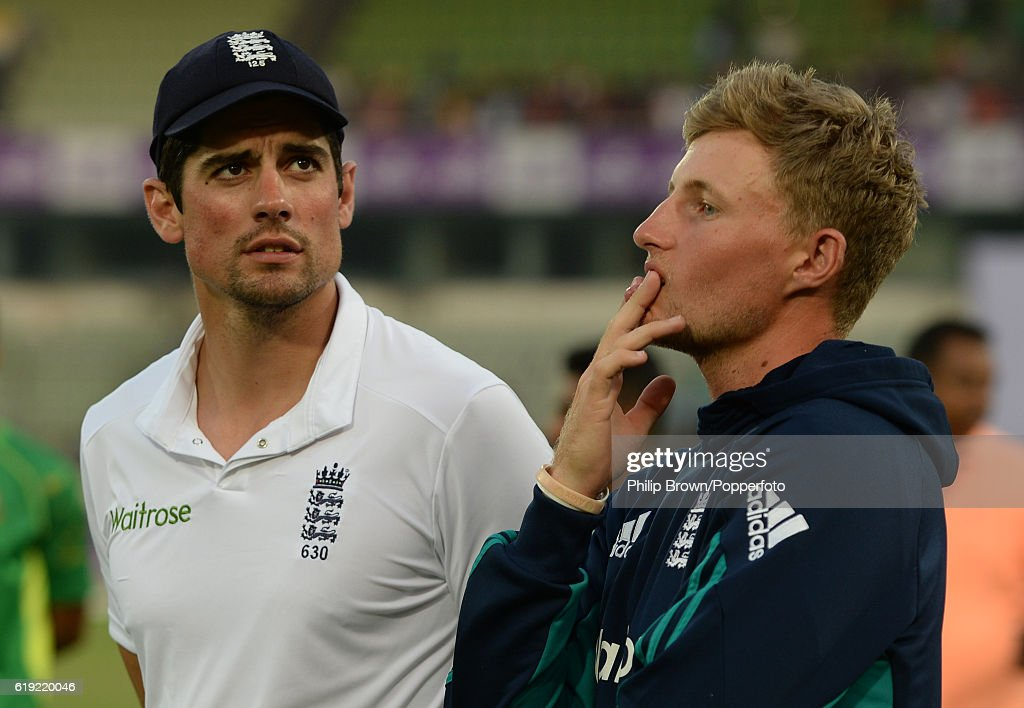 Alastair Cook stands with Joe Root after Bangladesh won the second test match between Bangladesh and England at Shere Bangla National Stadium on October 30, 2016 in Dhaka, Bangladesh.