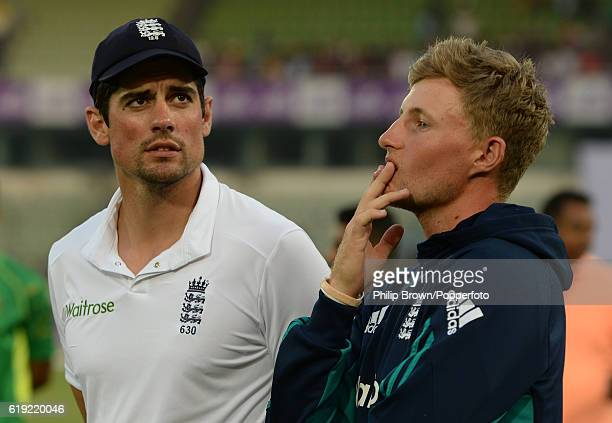 Alastair Cook stands with Joe Root after Bangladesh won the second test match between Bangladesh and England at Shere Bangla National Stadium on...