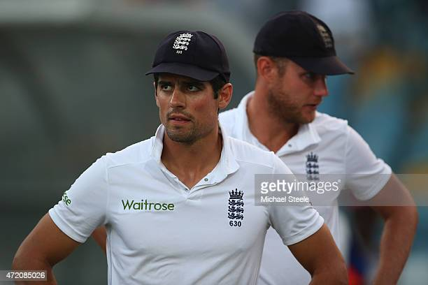 Alastair Cook the captain of England looks on at the after match presentations alongside Stuart Broad as the series was squared 11 after West Indies...