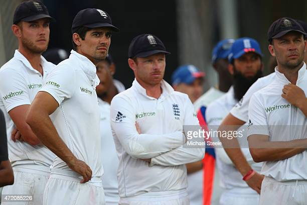 Alastair Cook the captain of England looks on at the after match presentations alongside Stuart Broad Ian Bell and Jonathan Trott as the series was...