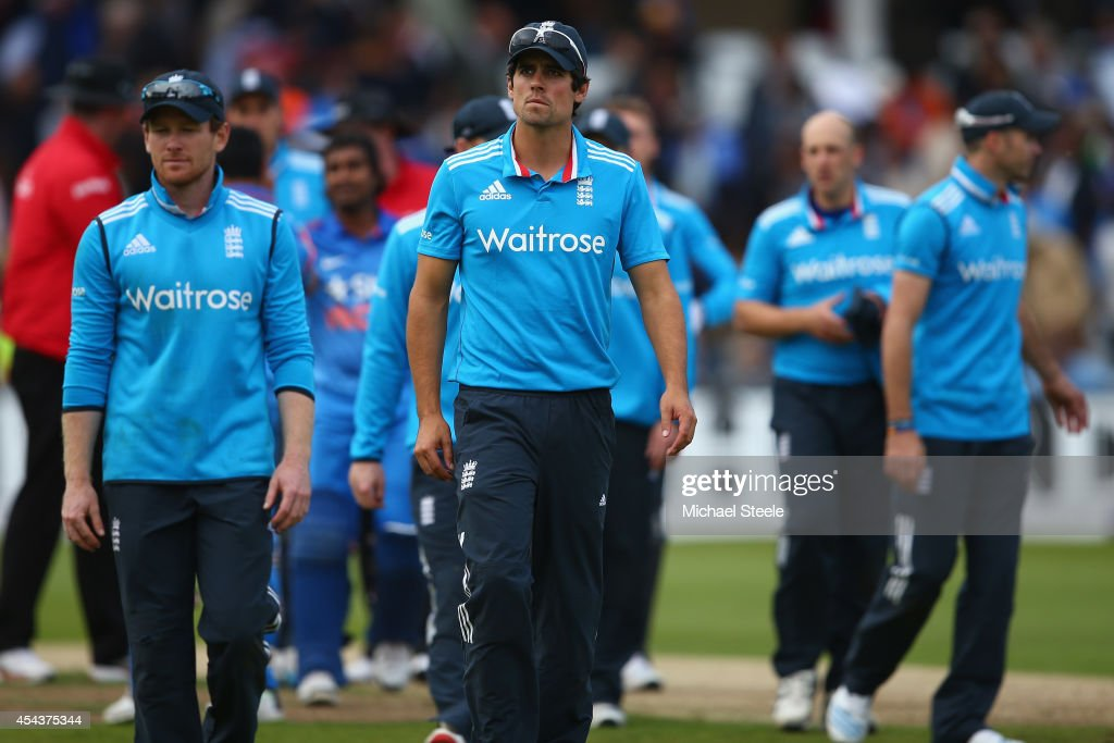 Alastair Cook (C) the captain of England walks from the field after his sides 6 wicket defeat during the third Royal London One-Day Series match between England and India at Trent Bridge on August 30, 2014 in Nottingham, England.