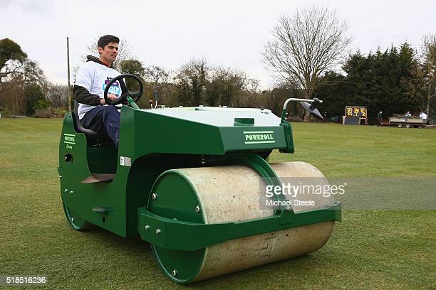 Alastair Cook the England captain rolls the square as he participates in the NatWest CricketForce 2016 scheme at Dymock Cricket Club on April 1 2016...