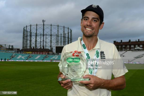 Alastair Cook with his player of the match trophy after England won the fifth Specsavers Test Match between England and India at The Kia Oval on...