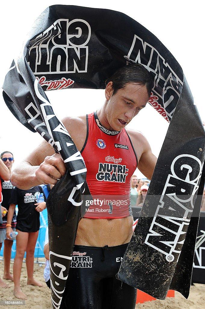 Alastair Day celebrates winning the Noosa Heads round of the 2012-13 Kelloggs Nutri-Grain Ironman Series on February 24, 2013 in Noosa, Australia.