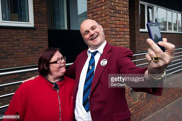 Alastair James Hay better known as comedian 'Al Murray' who portrays an English pub landlord takes a selfie photograph with a fan after handing in...