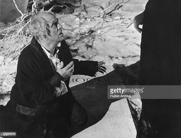 Alastair Sim as Scrooge in the film of the same name adapted from Charles Dickens' novel 'A Christmas Carol' directed by Brian Desmond Hurst and...