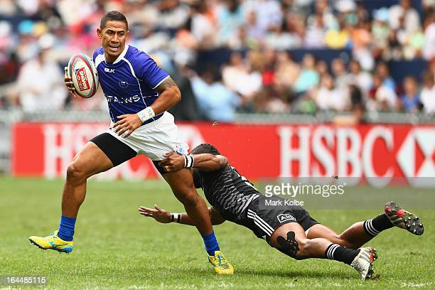 Alatasi Tupou of Samoa evades the tackle of Meki Magele of New Zealand during the cup quarter final match between New Zealand and Samoa day three of...