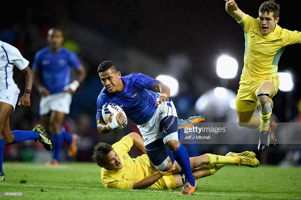 Alatasi Tupou of Samoa is tackled by Con Foley of Australia at Ibrox Stadium during bronze medal rugby sevens match on day four of the Glasgow 2014 Commonwealth Games on July 27, 2014 in Glasgow, United Kingdom.