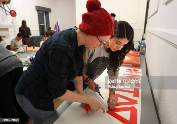 Alathea MilneHines is the lead organizer of the Me Too march in Toronto beside her is Jessica Parker She and other helpers made posters and signs at...