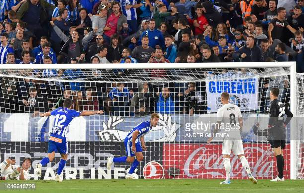 Alaves' Argentinian forward Calleri and Spanish midfielder Manuel Alejandro celebrate after scoring a goal during the Spanish league football match...