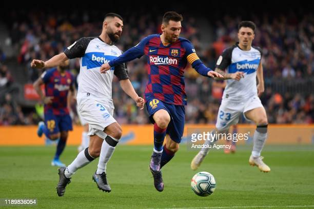 Alave's defender Ruben Duarte vies with Barcelona's Argentinian forward Lionel Messi during the Spanish League football match FC Barcelona vs Alaves...