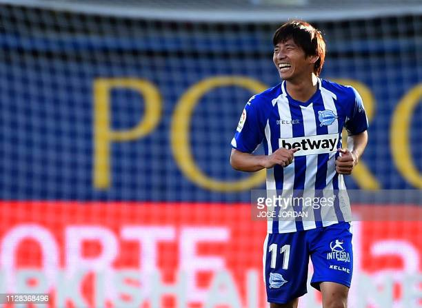 Alaves' Japanese midfielder Takashi Inui celebrates after scoring a goal during the Spanish league football match between Villarreal CF and Deportivo...