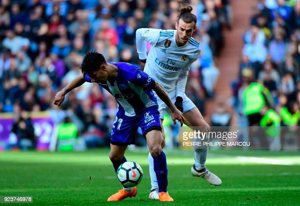 Alaves' Paraguayan forward Hernan Perez vies with Real Madrid's Welsh forward Gareth Bale during the Spanish league football match between Real...