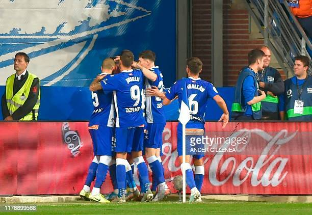 Alaves' players celebrate a goal scored by Alaves' Spanish forward Lucas Perez during the Spanish league football match between Deportivo Alaves and...