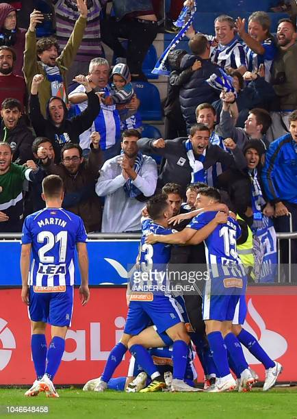 Alaves' players celebrate after scoring a goal during the Spanish league football match between Deportivo Alaves and Real Madrid CF at the...