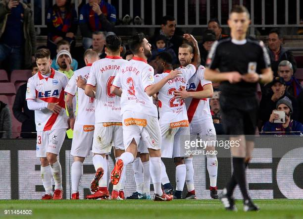Alaves players celebrate their opening goal during the Spanish league football match between FC Barcelona and Deportivo Alaves at the Camp Nou...