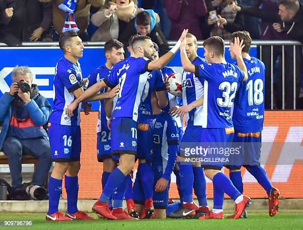Alaves players celebrate their second goal during the Spanish 'Copa del Rey' quarterfinal second leg football match between Deportivo Alaves and...