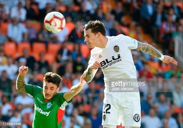 TOPSHOT Alaves' Spanish defender Joaquin Navarro vies with Valencia's Spanish forward Santi Mina during the Spanish League football match between...