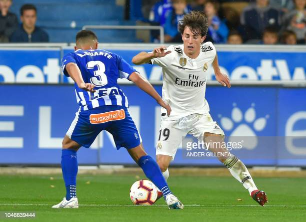 Alaves' Spanish defender Ruben Duarte vies with Real Madrid's defender Alvaro Odriozola during the Spanish league football match between Deportivo...