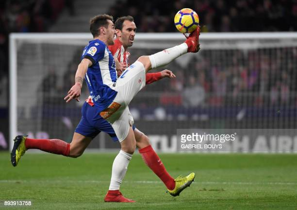 Alaves' Spanish forward Ibai Gomez vies with Atletico Madrid's Uruguayan defender Diego Godin during the Spanish league football match Club Atletico...