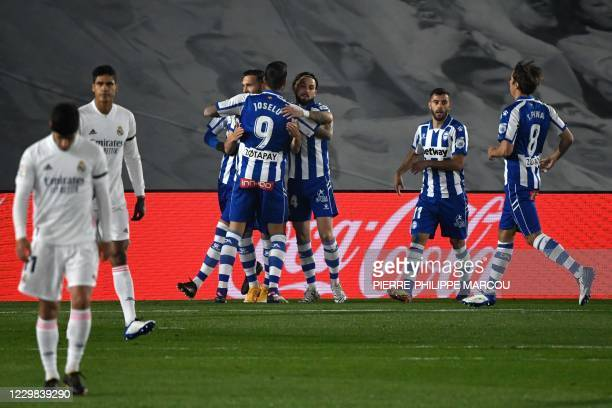Alaves' Spanish forward Lucas Perez celebrates his goal with teammates during the Spanish League football match between Real Madrid and Deportivo...