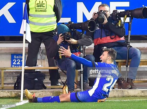 Alaves' Spanish forward Munir ElHaddadi celebrates after scoring his team's first goal during the Spanish 'Copa del Rey' quarterfinal second leg...