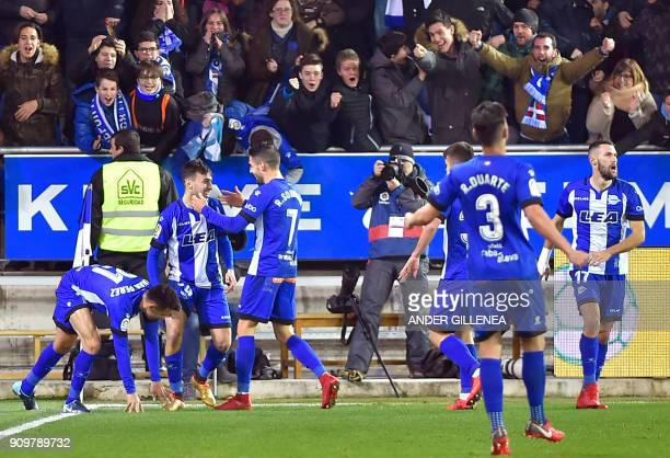 Alaves' Spanish forward Munir ElHaddadi celebrates with teammates after scoring his team's first goal during the Spanish 'Copa del Rey' quarterfinal...
