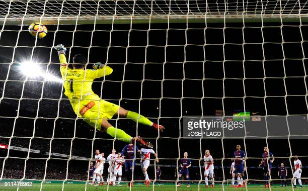 Alaves' Spanish goalkeeper Fernando Pacheco concedes a goal after a shot by Barcelona's Argentinian forward Lionel Messi during the Spanish league...