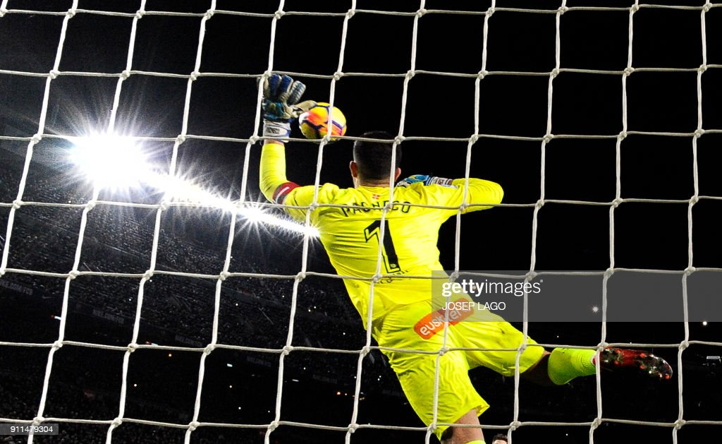 Alaves' Spanish goalkeeper Fernando Pacheco concedes a goal after a shot by Barcelona's Argentinian forward Lionel Messi during the Spanish league football match between FC Barcelona and Deportivo Alaves at the Camp Nou stadium in Barcelona on January 28, 2018. / AFP PHOTO / Josep LAGO