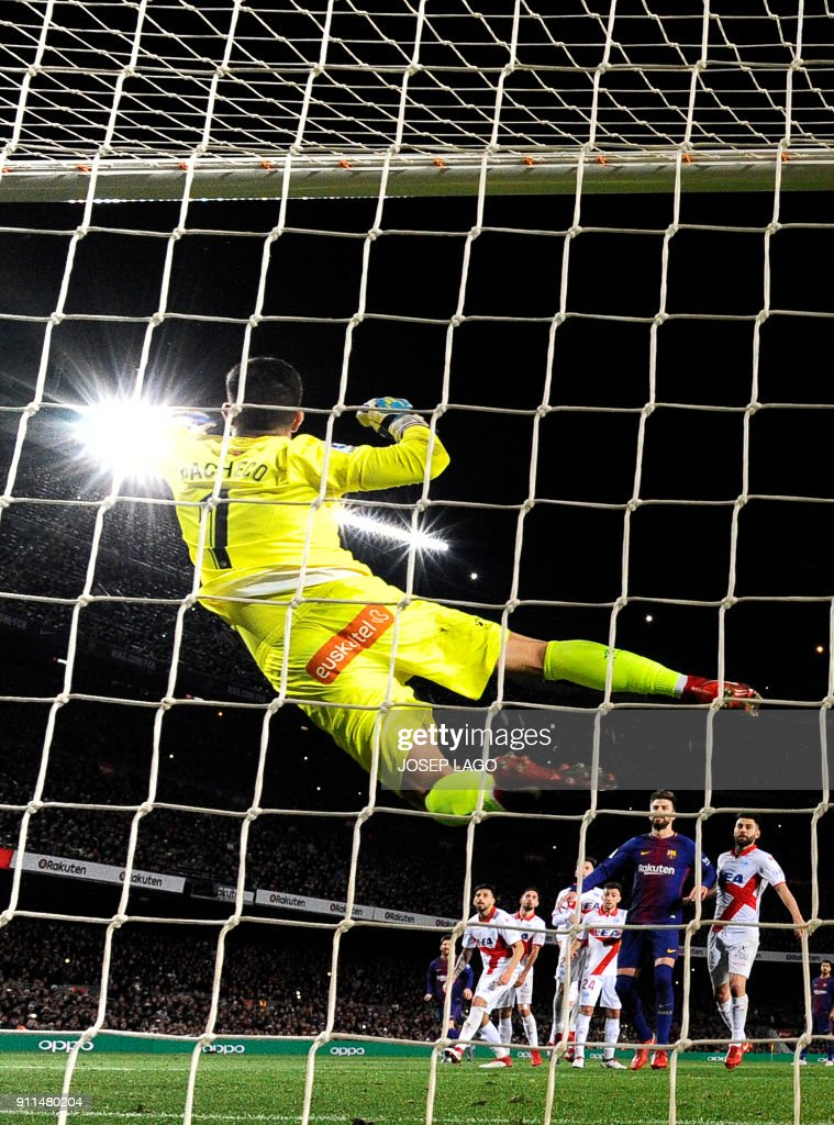 Alaves' Spanish goalkeeper Fernando Pacheco concedes a goal after a shot by Barcelona's Argentinian forward Lionel Messi (bottom L) during the Spanish league football match between FC Barcelona and Deportivo Alaves at the Camp Nou stadium in Barcelona on January 28, 2018. / AFP PHOTO / Josep LAGO