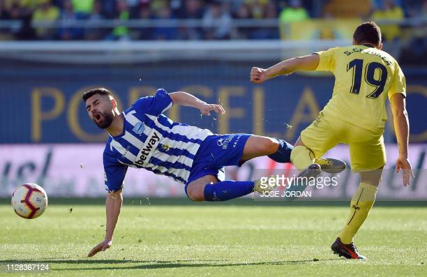 Alaves' Spanish midfielder Jony vies with Villarreal's Spanish midfielder Santi Cazorla during the Spanish league football match between Villarreal...