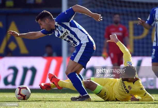 Alaves' Spanish midfielder Jony vies with Villarreal's Spanish midfielder Vicente Iborra during the Spanish league football match between Villarreal...