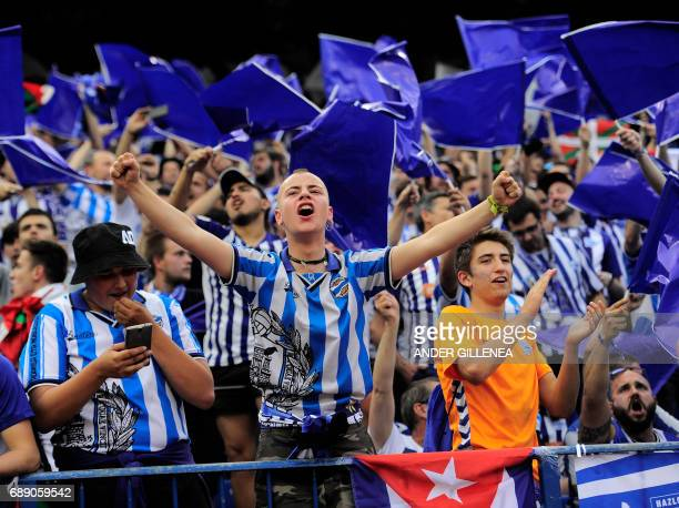 Alaves' supporters cheer their team before the Spanish Copa del Rey final football match FC Barcelona vs Deportivo Alaves at the Vicente Calderon...
