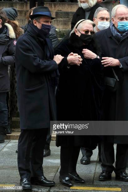 Alaxandre Brasseur and his mother Michele Cambon attend actor Claude Brasseur's funeral in Saint Roch Church on December 29, 2020 in Paris, France.