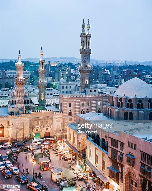 al-azhar mosque and city of cairo at dusk - cairo stock pictures, royalty-free photos & images