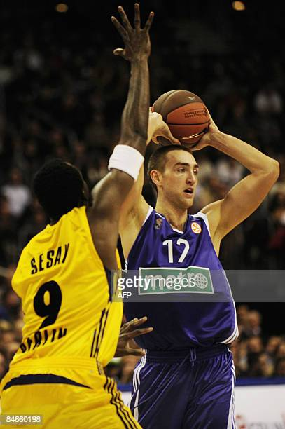 Alba Berlin's Ansu Sesay of the US vies with Real Madrid's Axel Marie Gustave Hervelle from Belgium during their Euroleague top 16 group F basketball...