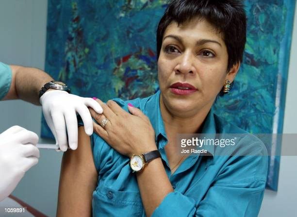 Alba Cerrato receives a shot of steroids from Dr Julio Siera at Mercy Hospital July 12 2002 in Miami Florida Cerrato contracted AIDS in 1994 from her...